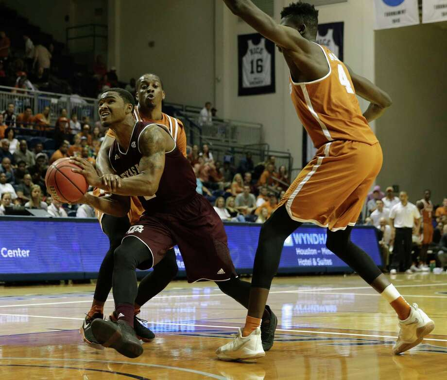 Texas A&M Aggies guard TJ Starks (2) is fouled by Texas Longhorns guard Matt Coleman (2) on the way to the basket in the second half during the exhibition basketball game between the Texas Longhorns and the Texas A&M Aggies to benefit the Rebuild Texas Relief Fund at Tudor Fieldhouse in Houston, TX on Wednesday, October 25, 2017. Photo: Tim Warner, Freelance / Houston Chronicle