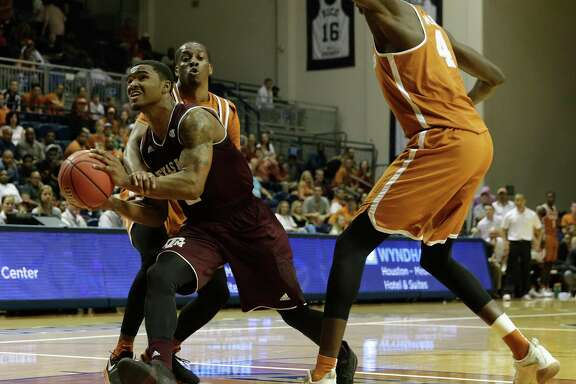 Texas A&M Aggies guard TJ Starks (2) is fouled by Texas Longhorns guard Matt Coleman (2) on the way to the basket in the second half during the exhibition basketball game between the Texas Longhorns and the Texas A&M Aggies to benefit the Rebuild Texas Relief Fund at Tudor Fieldhouse in Houston, TX on Wednesday, October 25, 2017.