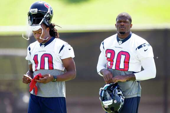 Houston Texans wide receivers DeAndre Hopkins (10) and Andre Johnson (80) walk across the practice field during Texans organized team activities at The Methodist Training Center Monday, June 3, 2013, in Houston. ( Brett Coomer / Houston Chronicle )