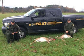 State Environmental Conservation Officers Shane Manns and Jason Hilliard pose with two illegally killed deer they seized on Oct. 28 in Broadalbin, NY.