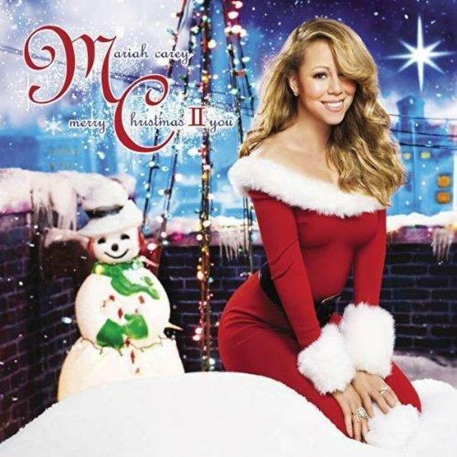 Mariah Carey is one of the many artists who'll be crooning Christmas songs on the new 24-7 holiday format on KQXT-FM (101.9). Photo: Island Records / ONLINE_YES