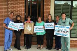 Barksdale & Hastings Dentistry staff shows off their Kingwood Strong attitude and happy to be Back2Biz.