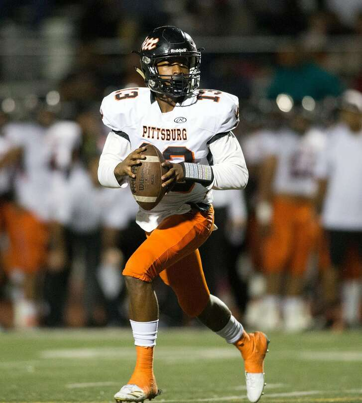 Pittsburg quarterback Justin Boyd (13) rolls out to pass against Freedom during the second quarter of a high school football game, Friday, Oct. 6, 2017 in Oakley, Calif.