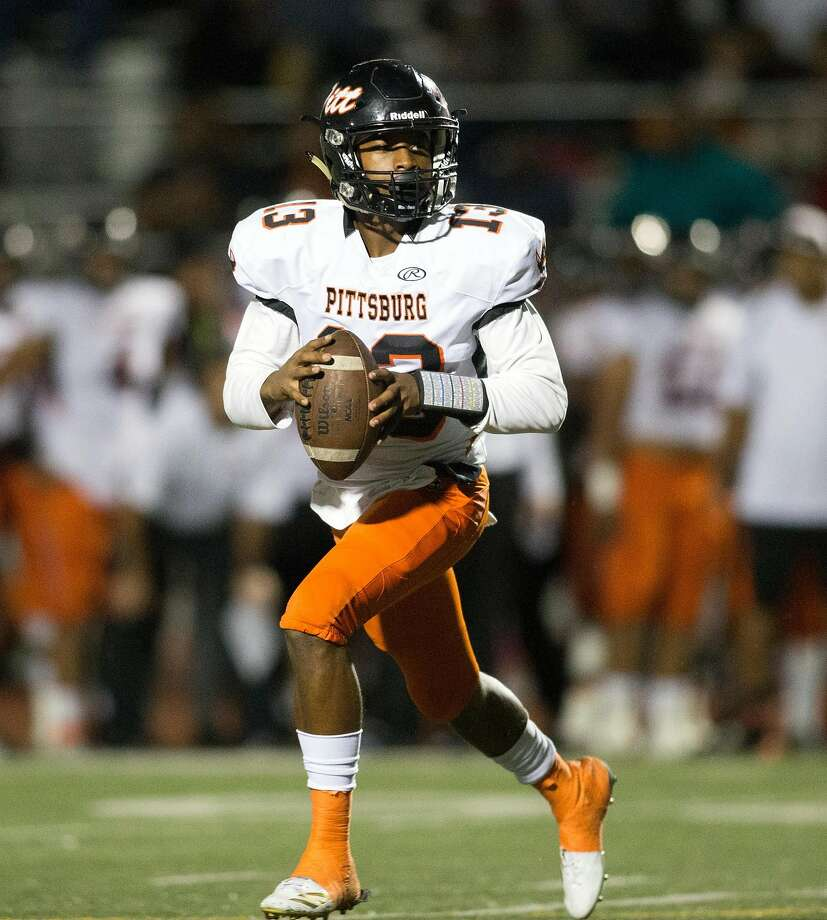 Pittsburg quarterback Justin Boyd (13) rolls out to pass against Freedom during a 47-33 win in October. Photo: D. Ross Cameron, Special To The Chronicle