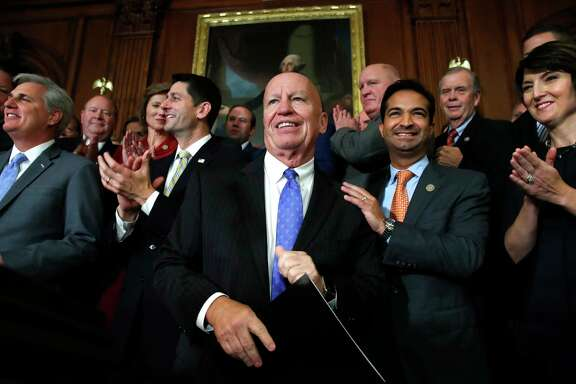 House Ways and Means Chair Rep. Kevin Brady, R-The Woodlands, center, is welcomed by House Republicans as they arrive to speak to the media following a vote on the GOP tax bill Thursday. (AP Photo/Jacquelyn Martin)