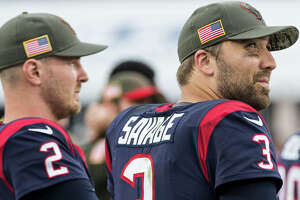 Houston Texans quarterback Tom Savage (3) looks up as he stands on the sidelines with T.J. Yates during the fourth quarter of an NFL football game against the Los Angeles Rams  at the Los Angeles Memorial Coliseum on Sunday, Nov. 12, 2017, in Los Angeles. ( Brett Coomer / Houston Chronicle )