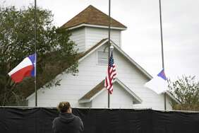 "Tonya Brockman of San Antonio pays her respects as she visits the First Baptist Church in Sutherland Springs, Texas, on Friday, Nov. 10, 2017. ""I felt like I needed to see it"", she said, adding ""it makes me wonder what kind of world we are leaving our kids""."
