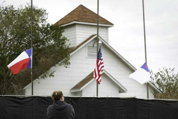 """Tonya Brockman of San Antonio pays her respects as she visits the First Baptist Church in Sutherland Springs, Texas, on Friday, Nov. 10, 2017. """"I felt like I needed to see it"""", she said, adding """"it makes me wonder what kind of world we are leaving our kids""""."""