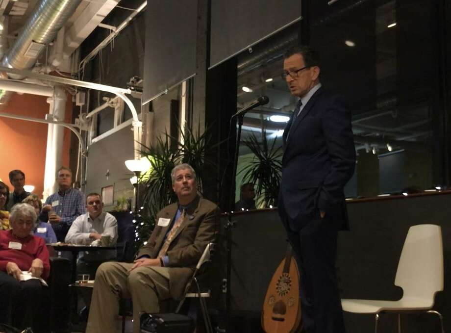 Gov. Dannel Malloy speakts during an Integrated Refugee & Immigrant Services celebration on Thursday, Nov. 16, at mActivity Fitness Center in New Haven. Photo: Esteban L. Hernandez / Hearst Connecticut Media