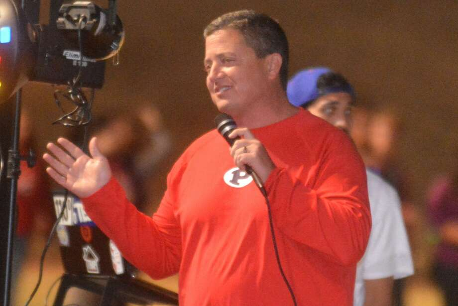 Plainview football coach Ryan Rhoades talks to the crowd at the pep rally. Photo: Skip Leon/Plainview Herald