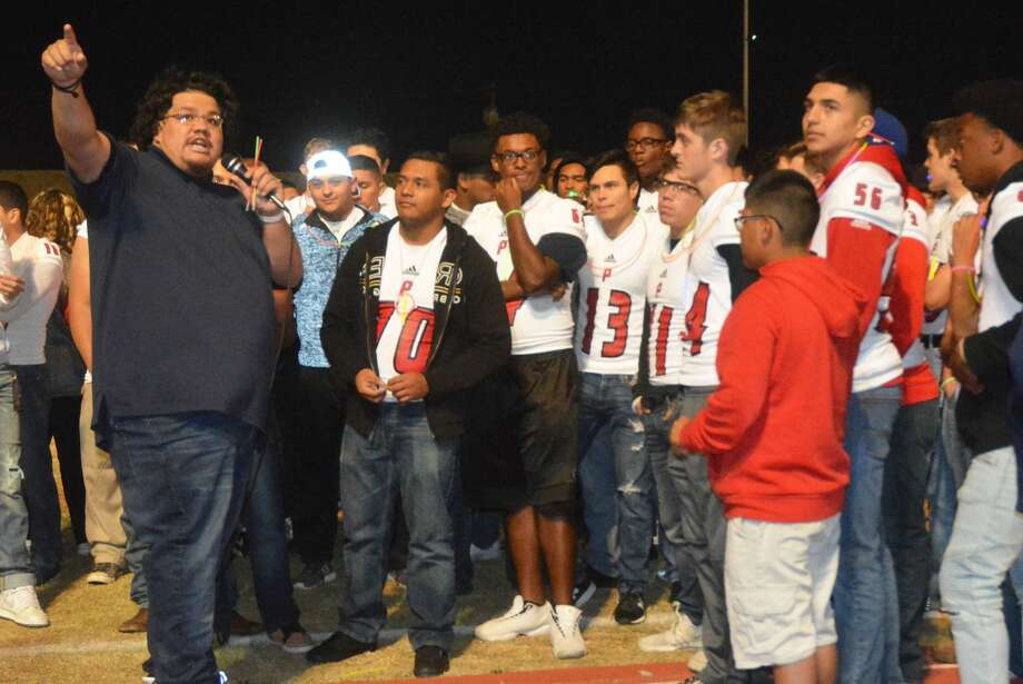Marco Ramirez, left, gives a motivational speech to the Plainview football team at a pep rally at the Wayland Baptist University soccer field Thursday night. Ramirez, who played on the 2005 Bulldog team that advanced to the regional finals, is an official with the Texas Association of Sports Officials (TASO). Photo: Skip Leon/Plainview Herald