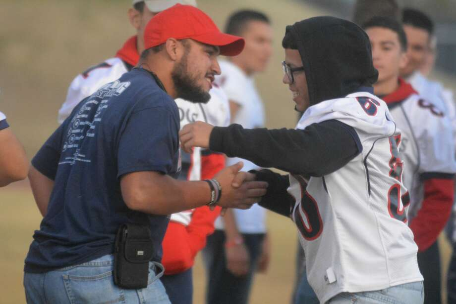 Football team manager Caleb Castillo, left, greets one of the players before the start of the pep rally. Photo: Skip Leon/Plainview Herald