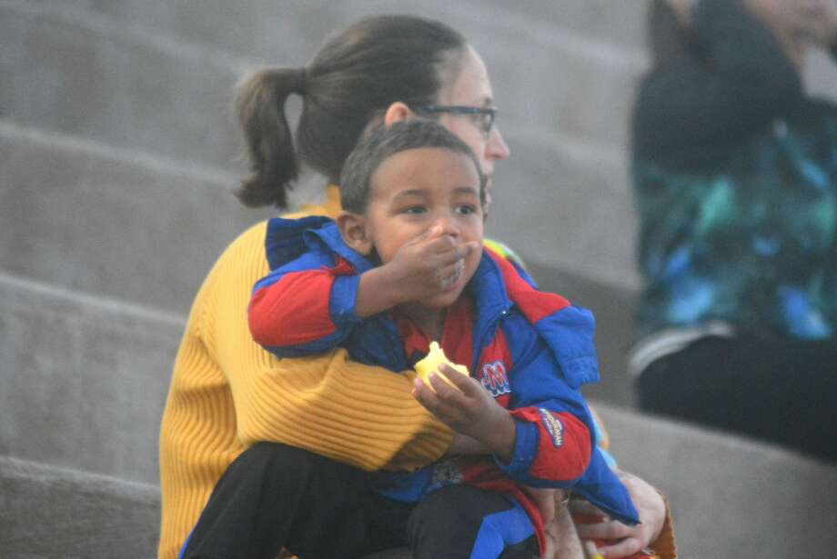 A future Bulldog? This youngster enjoys a snack as he waits for the pep rally to begin. Photo: Skip Leon/Plainview Herald