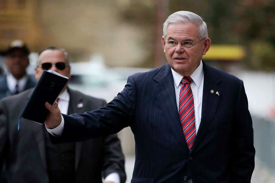 U.S. Sen. Bob Menendez waves at reporters before entering the Martin Luther King Jr. Federal Courthouse for his federal corruption trial, Thursday, Nov. 16, 2017, in Newark, N.J. Menendez is among the senators demanding oil industry contacts from federal agencies.  NEXT: See Houston restaurants offering meals for furloughed federal workers during the shutdown. Photo: Julio Cortez, STF / Copyright 2017 The Associated Press. All rights reserved.