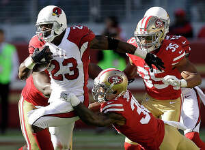 FILE- In this Sunday, Nov. 5, 2017, file photo, Arizona Cardinals running back Adrian Peterson (23) runs against the San Francisco 49ers during the first half of an NFL football game in Santa Clara, Calif. With quarterback Carson Palmer out with a broken arm, Arizona is leaning on Peterson even more. (AP Photo/Ben Margot, File)