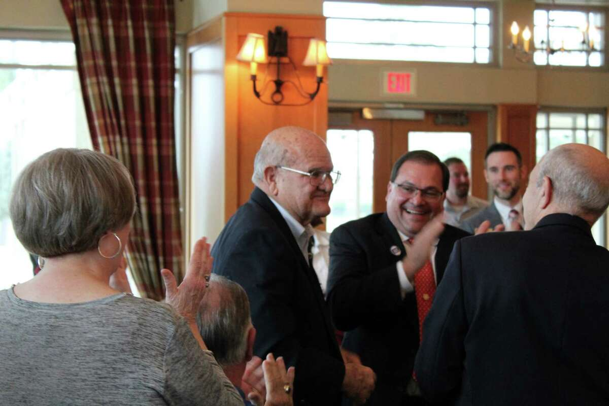 People applaud city of Humble Mayor Merle Aaron after he is announced as the 2017 Haden McKay, MD Citizen of the Year recipient during the Small Business Salute Luncheon at Golf Club of Houston in Humble on Thursday, Nov. 16.