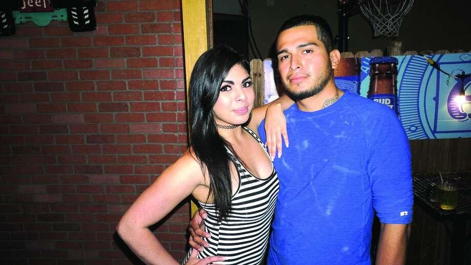 Mari Martinez and Noel Zamora at The Happy Hour Downtown BarFriday, November 17, 2017 Photo: Jose Gustavo Morales