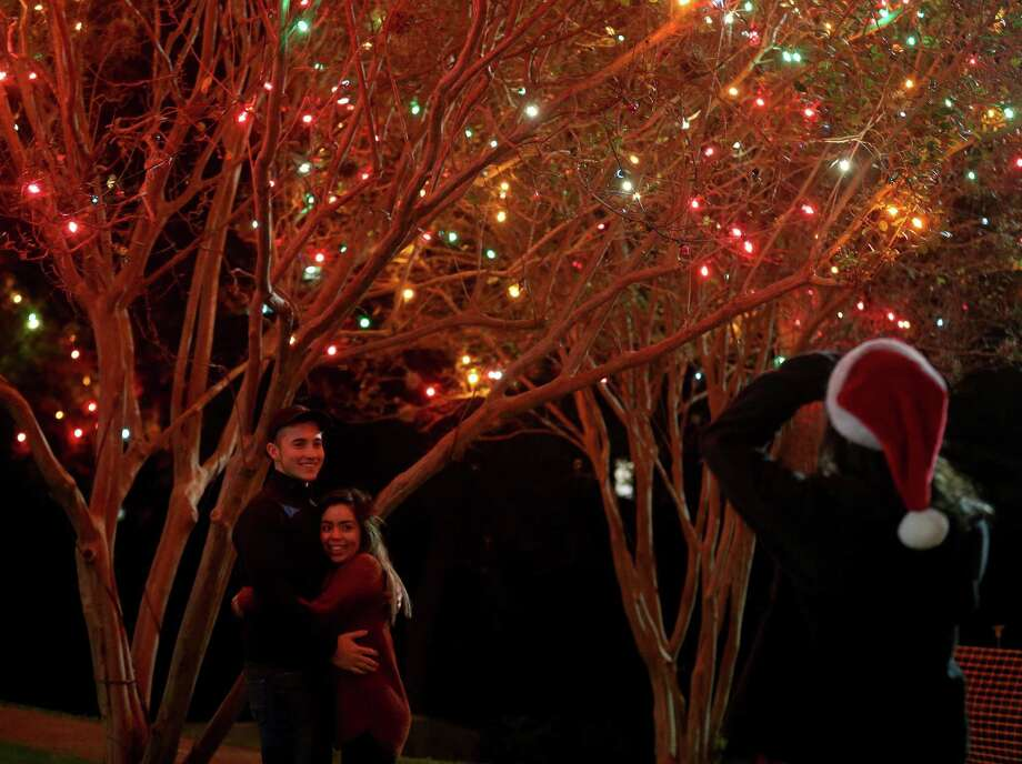 Bear Evans (left) and Kassya Gomez are photographed with the holiday lights by Violeta Sanchez after attending the University of the Incarnate Word's 30th annual Light the Way event held last year. Photo: Edward A. Ornelas /San Antonio Express-News / © 2016 San Antonio Express-News