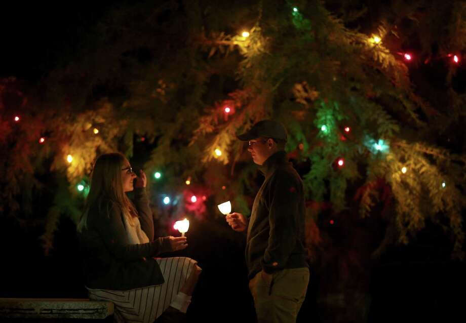University of the Incarnate Word senior Crystal Frost (left) and her boyfriend Texas A&M senior Elisha Gerhard enjoy the holiday lights after attending the University of the Incarnate Word's 30th annual Light the Way event held lasty year. Photo: Edward A. Ornelas /San Antonio Express-News / © 2016 San Antonio Express-News