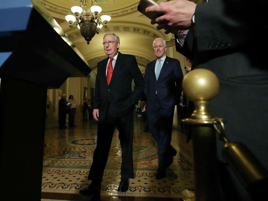 WASHINGTON, DC - NOVEMBER 14:  Senate Majority Leader Mitch McConnell (R-KY),(L), and Sen. John Cornyn (R-TX), walk up to speak to reporters about the proposed Senate Republican tax bill, after attending the Senate GOP policy luncheon, at US Capitol on November 14, 2017 in Washington, DC.  (Photo by Mark Wilson/Getty Images) Photo: Mark Wilson / Getty Images / 2017 Getty Images