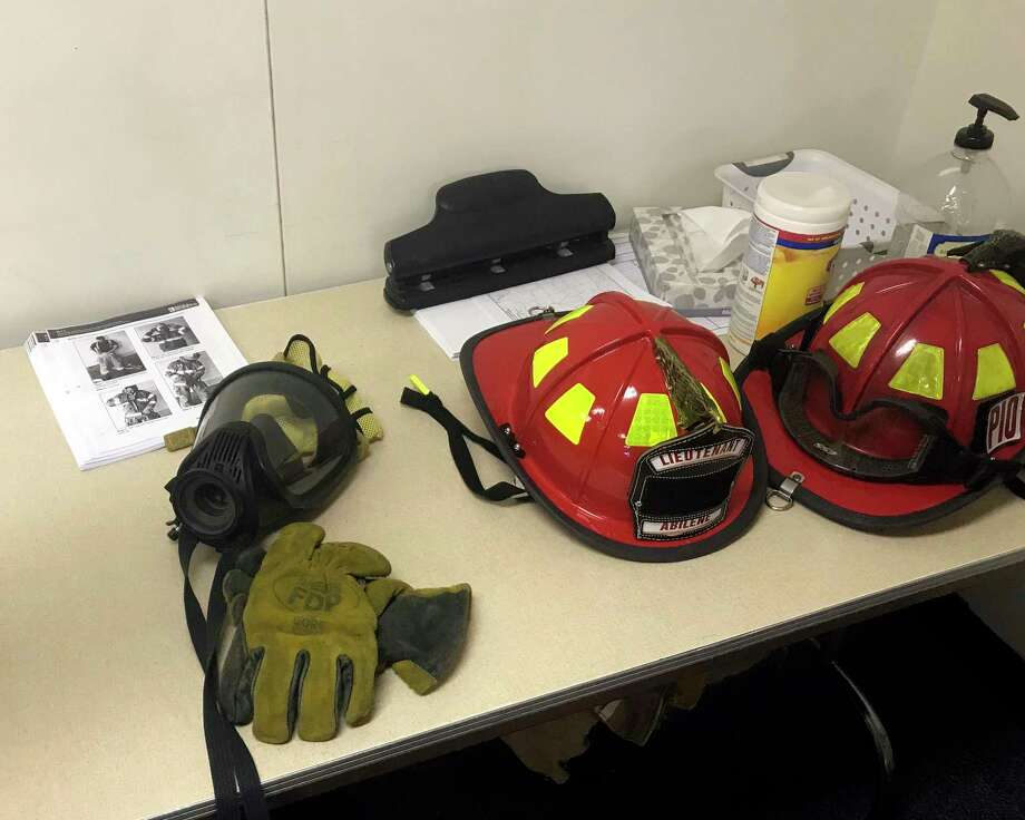 ADVANCE FOR MONDAY, NOV. 20 - In this Friday, Nov. 3, 2017 photo, equipment used to protect firefighters is displayed on a table in a portable classroom at Abilene High School in Abilene, Texas. The firefighter training courses won't officially begin until next year, when former Abilene Fire Department Lt. Mike Miller introduces the first two semesters of a planned four-semester program. (Timothy Chipp/The Abilene Reporter-News via AP) Photo: Timothy Chipp, AP / The Abilene Reporter-News