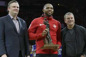 Houston Rockets guard Eric Gordon (10) accepts the NBA Sixth Man of the Year Award from owner Tilman Fertitta as general manager Daryl Morey is next to him during the opening of the NBA game against the Memphis Grizzlies at Toyota Center Monday, Oct. 23, 2017, in Houston. ( Yi-Chin Lee / Houston Chronicle )