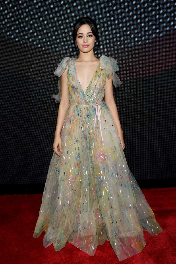 "Camila Cabello took the word upcycling to heart with this look. We are loving the colors...not so much the ""recycled plastic"" look.Click through for more of the Latin Grammy's best and worst looks. Photo: Rodrigo Varela/Getty Images For LARAS"