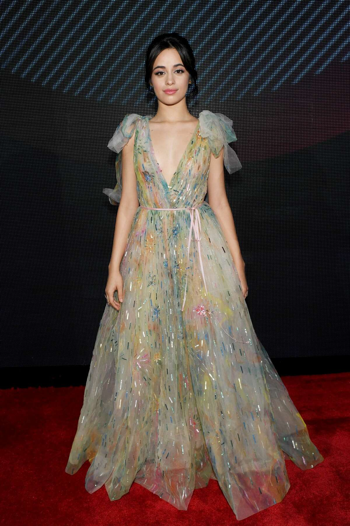 """Camila Cabello took the word upcycling to heart with this look. We are loving the colors...not so much the """"recycled plastic"""" look. Click through for more of the Latin Grammy's best and worst looks."""