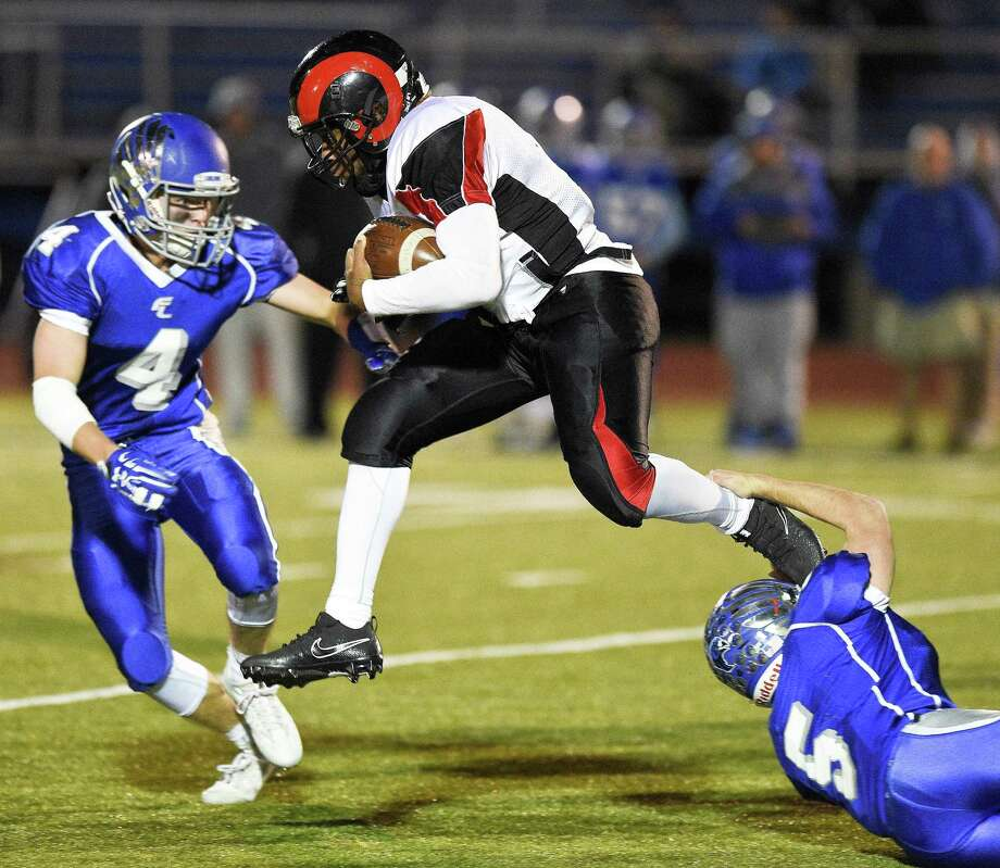 Bridgeport Central's Dimitrie Ivey (8) leaps over Fairfield Ludlowe Kevin Quinn (5), breaking past John Blatt (4) in a FCIAC football game at Fairfield Ludlowe High School Taft Field in Fairfield, Connecticut on Thursday, Nov. 16, 2017. Bridgeport Central defeated Ludlowe 46-44. Photo: Matthew Brown / Hearst Connecticut Media / Stamford Advocate