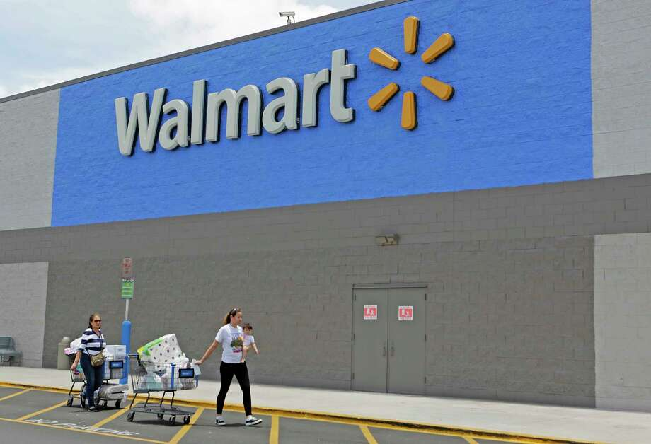 FILE - In this Thursday, June 1, 2017, file photo, customers walk out of a Walmart store in Hialeah Gardens, Fla. Wal-Mart Stores Inc. reports earnings, Thursday, Nov. 16, 2017. (AP Photo/Alan Diaz, File) Photo: Alan Diaz, STF / Copyright 2017 The Associated Press. All rights reserved.