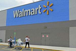 FILE - In this Thursday, June 1, 2017, file photo, customers walk out of a Walmart store in Hialeah Gardens, Fla. Wal-Mart Stores Inc. reports earnings, Thursday, Nov. 16, 2017. (AP Photo/Alan Diaz, File)