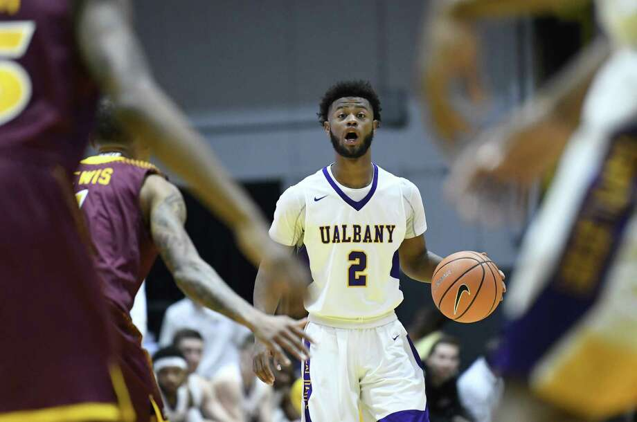 Albany Great Danes guard Ahmad Clark (2) moves the ball against the Iona Gaels defenders during the first half of an NCAA men's college basketball game on Friday, Nov. 10, 2017, in Albany, N.Y. (Hans Pennink / Special to the Times Union) ORG XMIT: HP114 ORG XMIT: MER2017111021562053 Photo: Hans Pennink / 20042056A