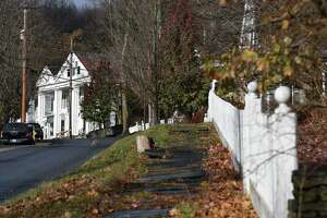 View looking up Route 351 toward the Palmer House Cafe on Thursday, Nov. 16, 2017, in Rensselaerville N.Y. Town residents recently banded together to raise $15,000 for Puerto Rico recover through a party and auction at Conkling Hall that attracted more than 200 attendees. (Will Waldron/Times Union)