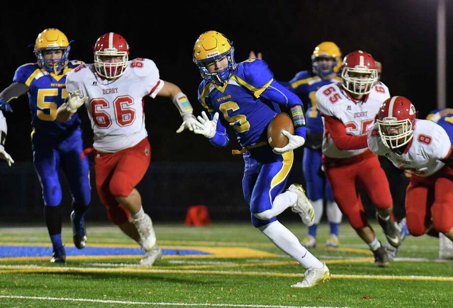 Bobby Melms (6) of the Seymour Wildcats scores on the first play from scrimmage during a game against the Derby Red Raiders at Seymour High School on Thursday November 16, 2017 in Seymour, Connecticut. Photo: Gregory Vasil / For Hearst Connecticut Media / Connecticut Post Freelance