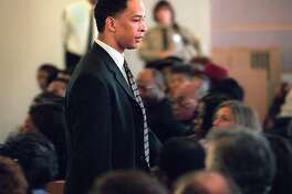 Former Carolina Panthers receiver Rae Carruth exits the courtroom in Charlotte, N.C., Monday, Jan. 22, 2001, after Judge Charles Lamm sentenced him to at least 18 years and 11 months and a maximum of 24 years and four months in the murder of his former girlfriend Cherica Adams. (AP Photo/Jeff Siner,Pool)