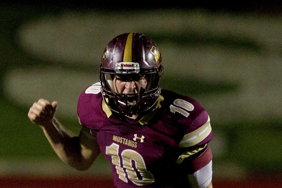 Magnolia West quarterback John Matocha (10) reacts after the team was called for a false start during the second quarter of a Region III-5A bi-district high school football game at Merrill Green Stadium, Friday, Nov. 17, 2017, in Bryan.