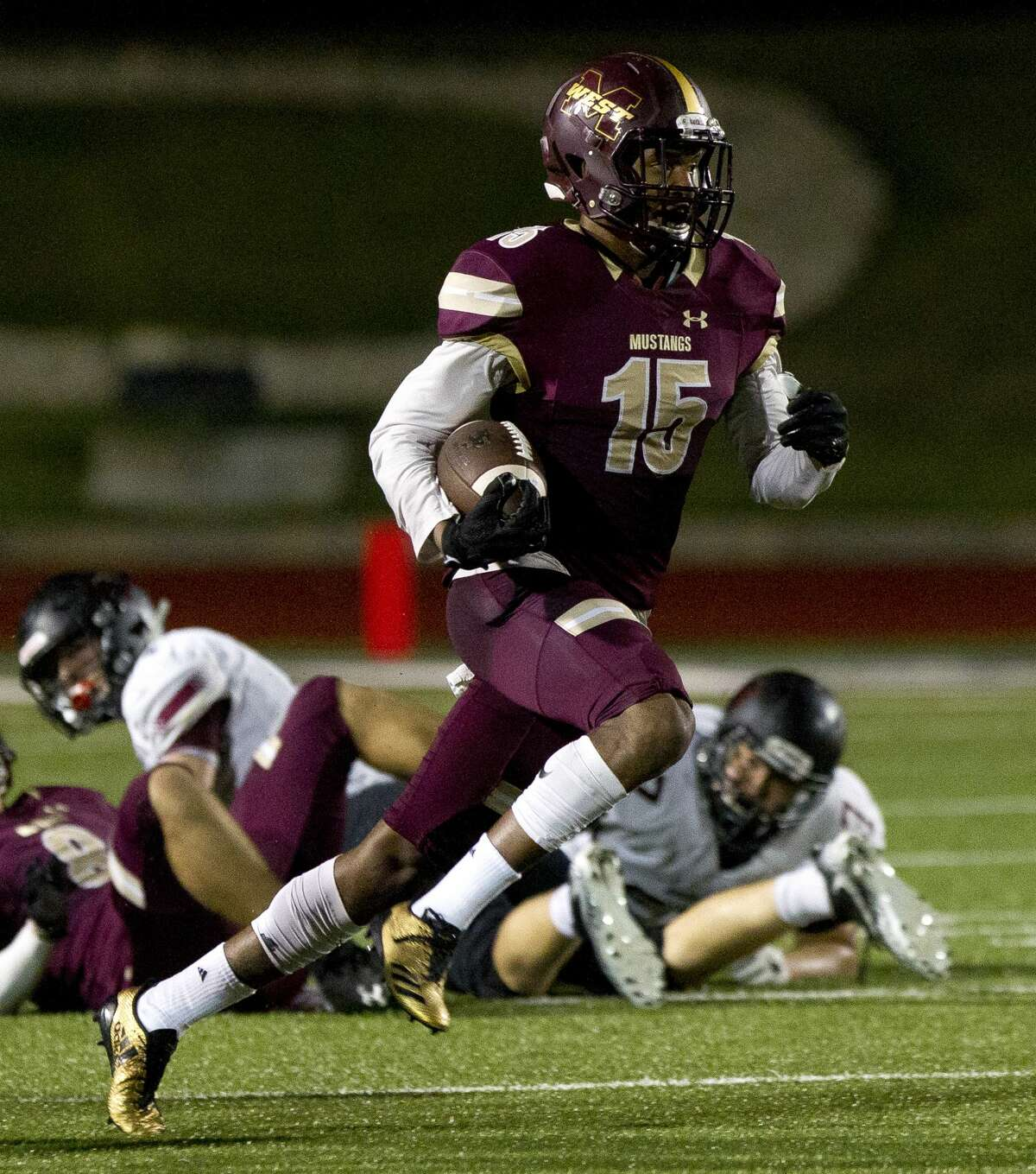 Magnolia West cornerback Ryan Franks (15) return the ball after intercepting a pass from Rouse quarterback Ethan Moore (18) during the second quarter of a Region III-5A bi-district high school football game at Merrill Green Stadium, Friday, Nov. 17, 2017, in Bryan.