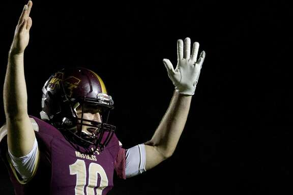Magnolia West quarterback John Matocha looks for a touchdown call after running back Zach Ogden's 2-yard run during the fourth quarter of a Region III-5A bi-district high school football game at Merrill Green Stadium, Friday, Nov. 17, 2017, in Bryan.