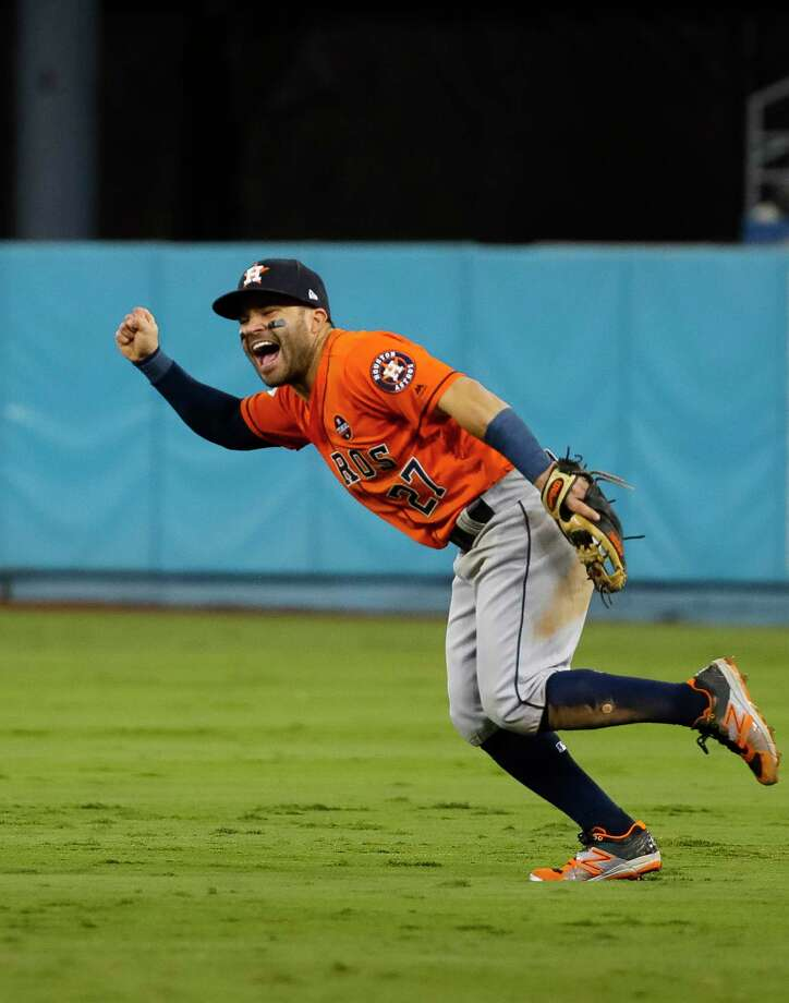 Houston Astros second baseman Jose Altuve (27) celebrates the Astros 5-1 win over the Los Angeles Dodgers after throwing the final out of Game 7 of the World Series at Dodger Stadium on Wednesday, Nov. 1, 2017, in Los Angeles. ( Karen Warren  / Houston Chronicle ) Photo: Karen Warren, Houston Chronicle / © 2017 Houston Chronicle