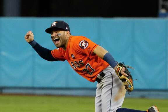 Houston Astros second baseman Jose Altuve (27) celebrates the Astros 5-1 win over the Los Angeles Dodgers after throwing the final out of Game 7 of the World Series at Dodger Stadium on Wednesday, Nov. 1, 2017, in Los Angeles. ( Karen Warren  / Houston Chronicle )