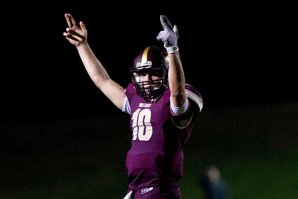 Magnolia West quarterback John Matocha (10) celebrates after throwing a 11-yard touchdown pass to tight end Simon Gonzalez during the second quarter of a Region III-5A bi-district high school football game at Merrill Green Stadium, Friday, Nov. 17, 2017, in Bryan.