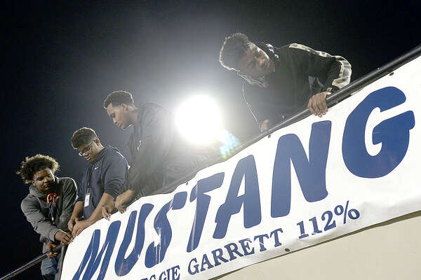 West Orange - Stark's fans affix banners to their stadium seating area as they get ready for game action against Brookshire Royal during their play-off game Thursday at Stallworth Stadium. Photo taken Thursday, November 16, 2017 Kim Brent/The Enterprise