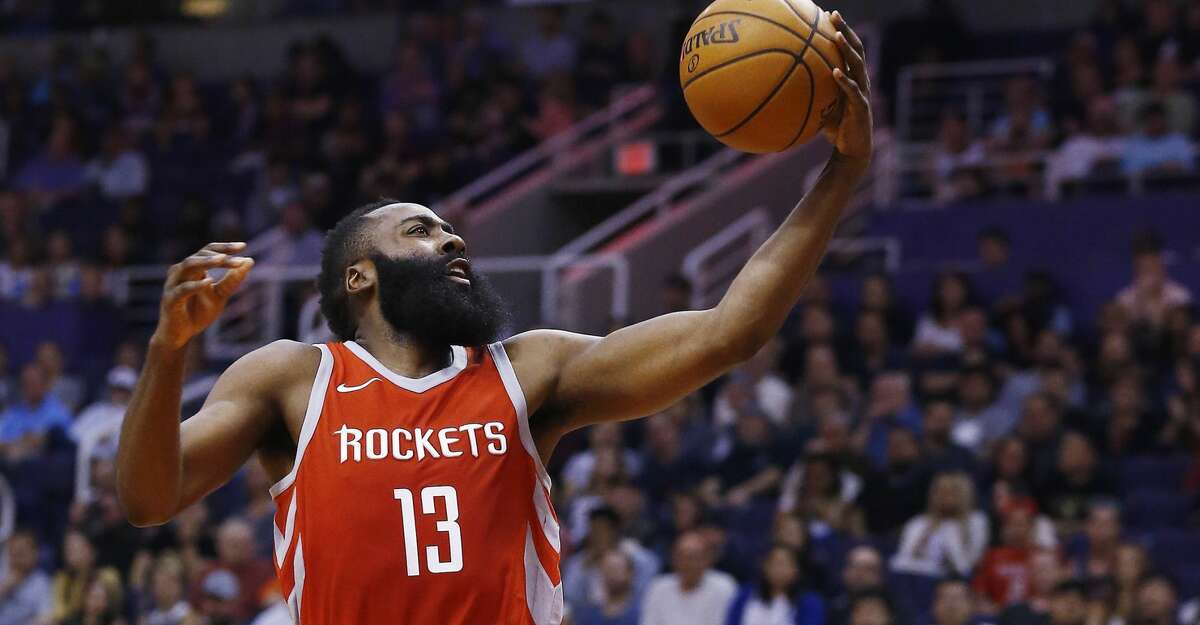 Rockets guard James Harden (13) said he doesn't care that he leads the NBA in points per game and assists per game. He just wants to win a title.