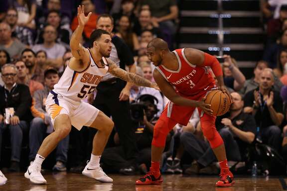 PHOENIX, AZ - NOVEMBER 16: Chris Paul #3 of the Houston Rockets handles the ball against Mike James #55 of the Phoenix Suns during the second half of the NBA game at Talking Stick Resort Arena on November 16, 2017 in Phoenix, Arizona.  The Rockets defeated the Suns 142-116.  NOTE TO USER: User expressly acknowledges and agrees that, by downloading and or using this photograph, User is consenting to the terms and conditions of the Getty Images License Agreement.  (Photo by Christian Petersen/Getty Images)