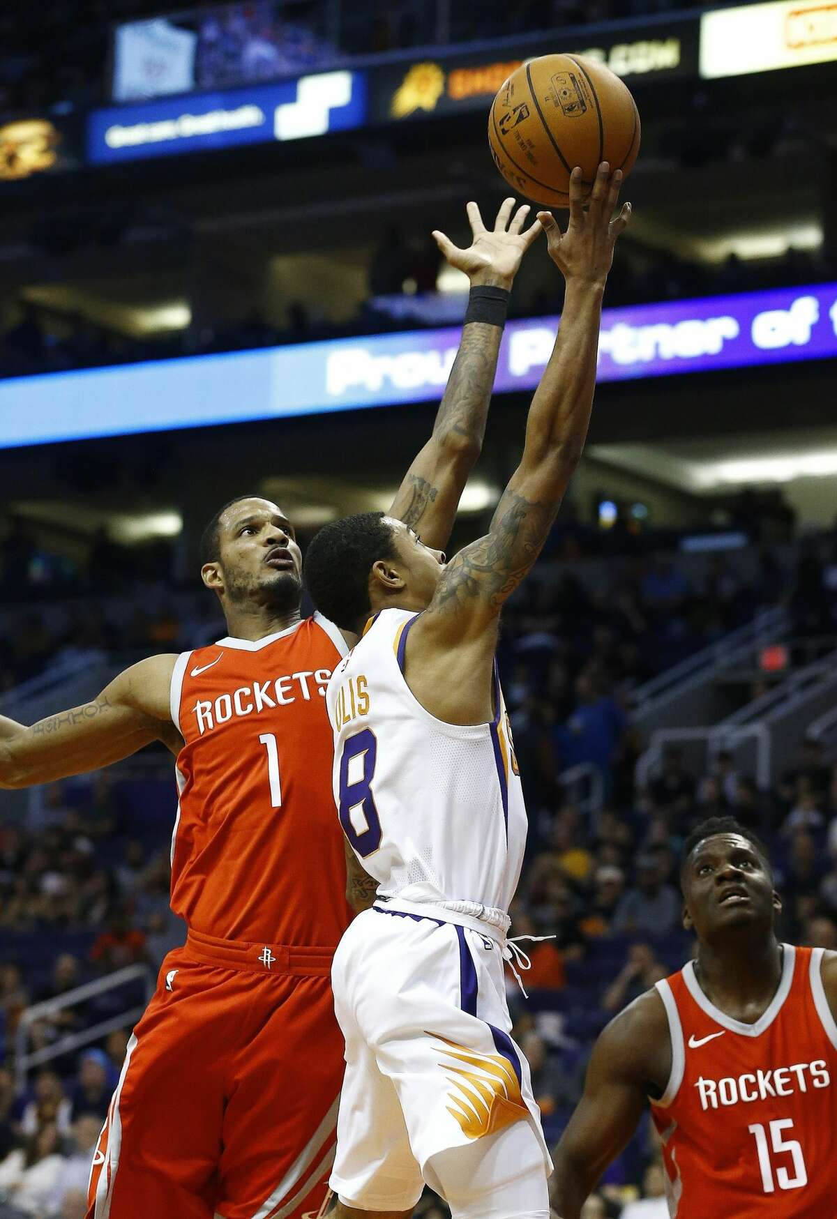 Houston Rockets forward Trevor Ariza (1) jumps to block the shot of Phoenix Suns guard Tyler Ulis (8) as Rockets center Clint Capela (15) watches during the second half of an NBA basketball game Thursday, Nov. 16, 2017, in Phoenix. The Rockets defeated the Suns 142-116. (AP Photo/Ross D. Franklin)