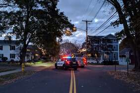 Milford police block streets around a High Street apartment building where a person was barricaded in one of the units on Friday, Nov. 17, 2017.
