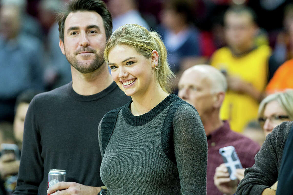 Newly married model Kate Upton uploaded a video of her pushing new husband up a hill as part of an exorcise routine. Swipe through to see photos proving the two are Houston's most popular couple.
