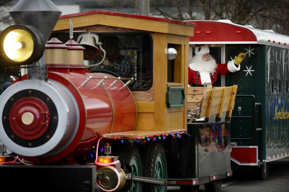 Santa waves to the crowd aboard the Northern Star Express during the Midland Santa Parade in 2016.