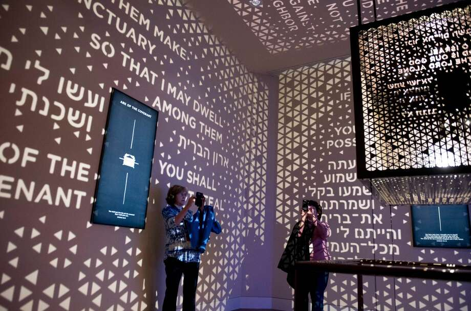 "Visitors walk through the Ark of the Covenant exhibit as part of the ""Journey through the Hebrew Bible"" exhibit during a media preview of the new Museum of the Bible, a museum dedicated to the history, narrative and impact of the Bible, in Washington, DC, November 14, 2017. Photo: SAUL LOEB/AFP/Getty Images"