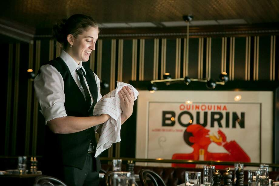 A server polishes glasses before service at Gaspar. Photo: John Storey, Special To The Chronicle